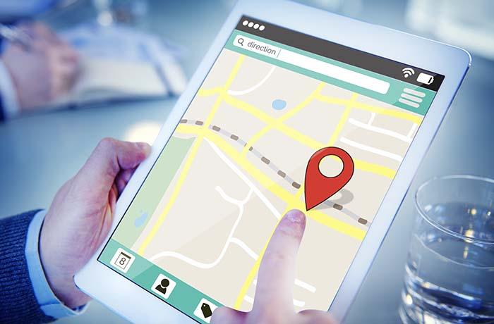 Man on a Digital Tablet using Online Map